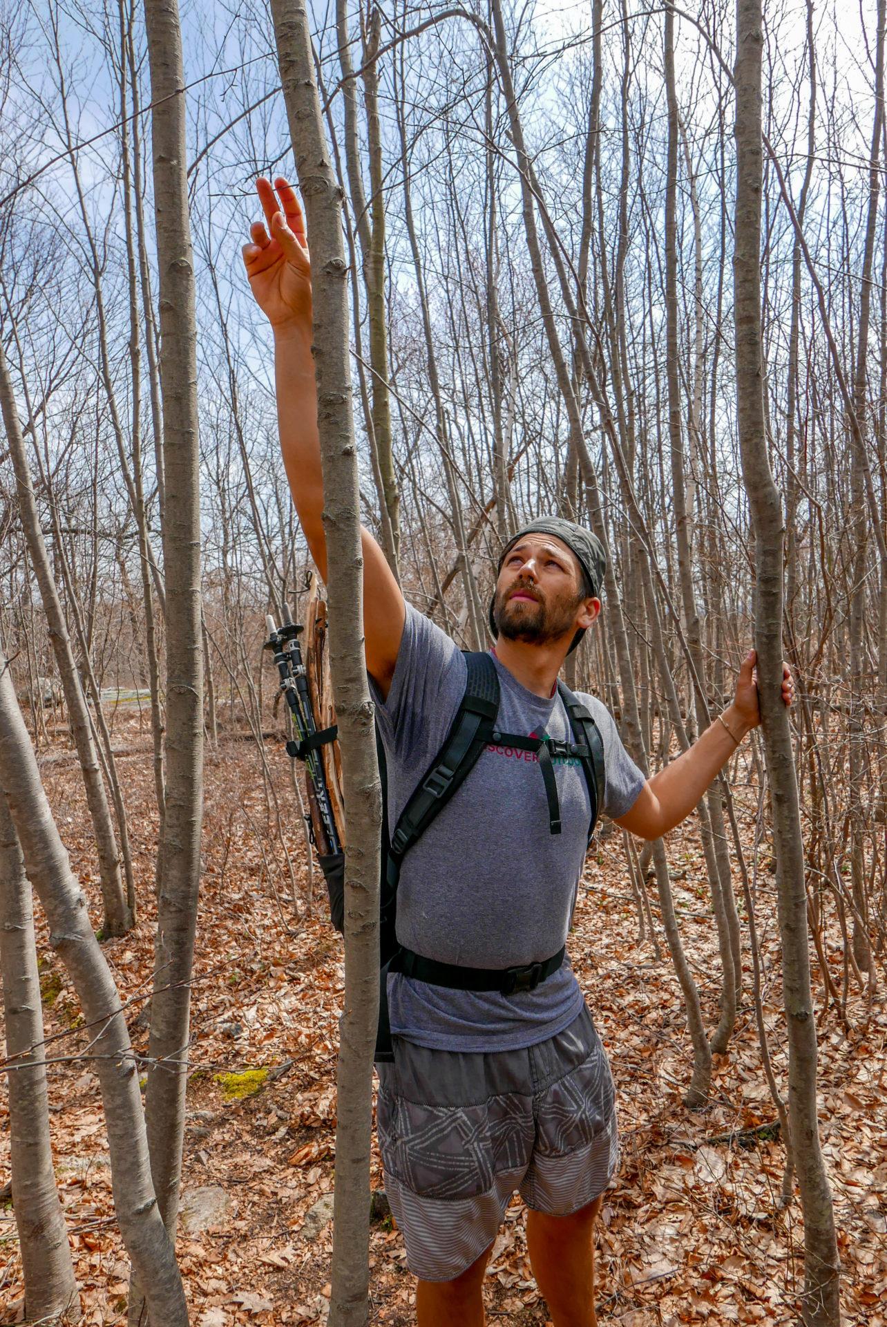 Zach grabs some birch sap to taste