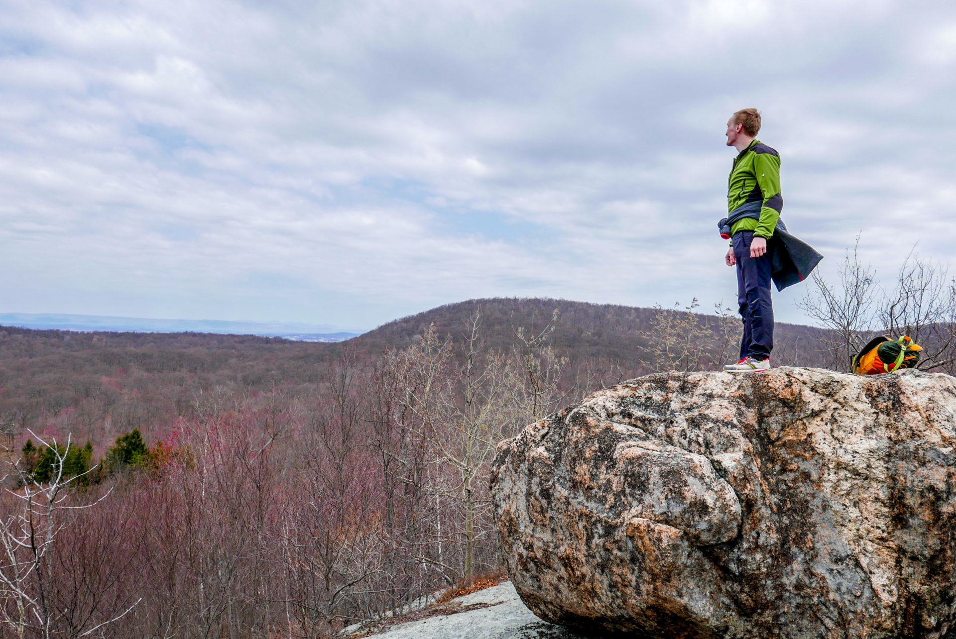 Perica looks into the distance atop a glacial erratic