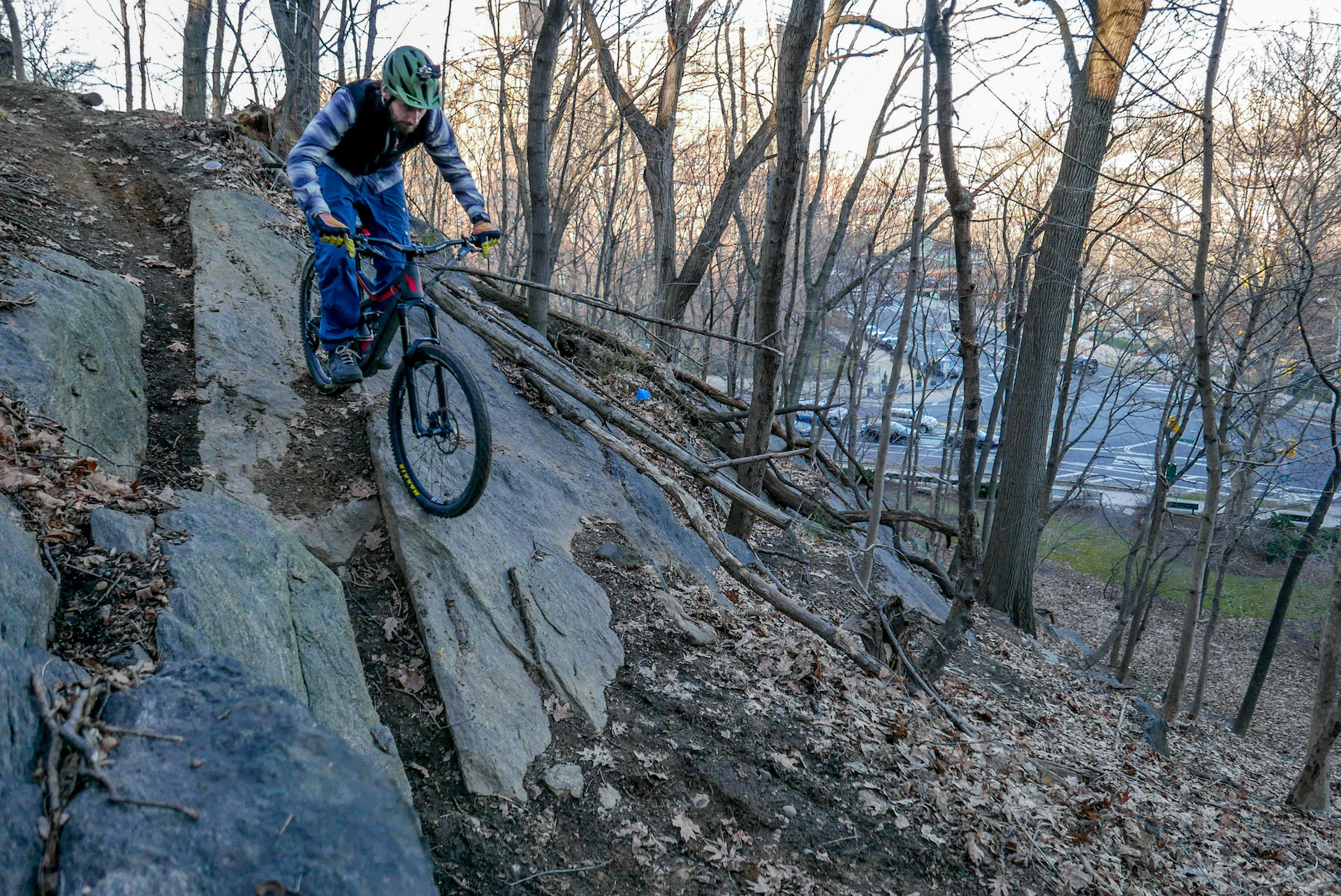 Dropping in on a large boulder.