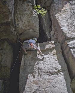 Climber climbing some crack rock