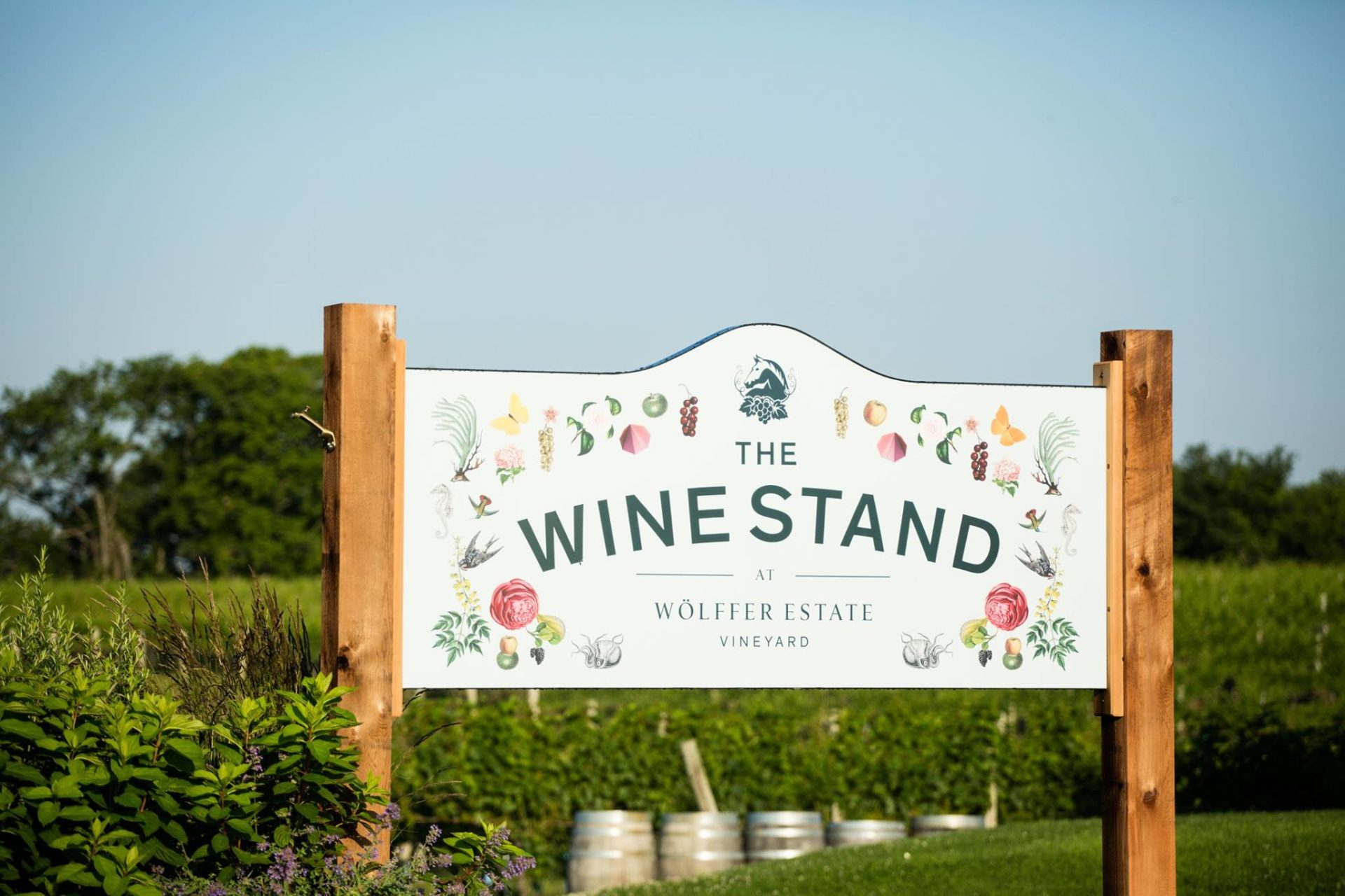 Wine Stand sign. Photo by Wölffer Estates via Facebook.