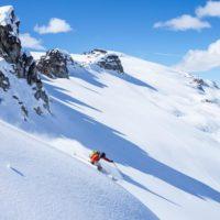 Incredible downhill run with a mountain as a backdrop