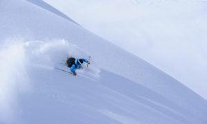 Skier shredding some powder