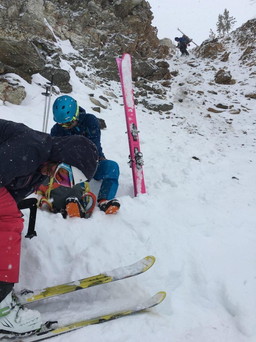 Skier's beginning to rappel