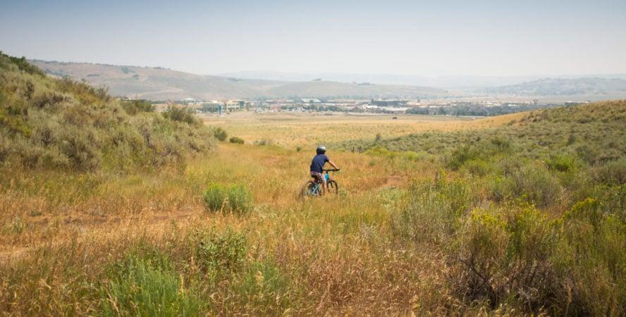Kid riding mountain bike in Park City, Utah