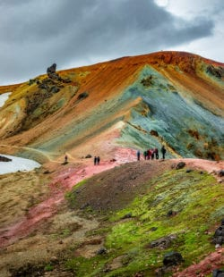 Beautiful colorful volcanic mountains Landmannalaugar and hikers on trail, Iceland, summer time