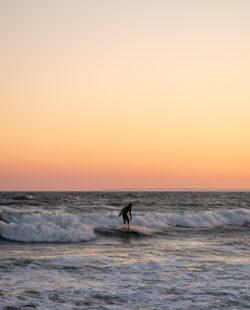Surfer at Rockaway Beach