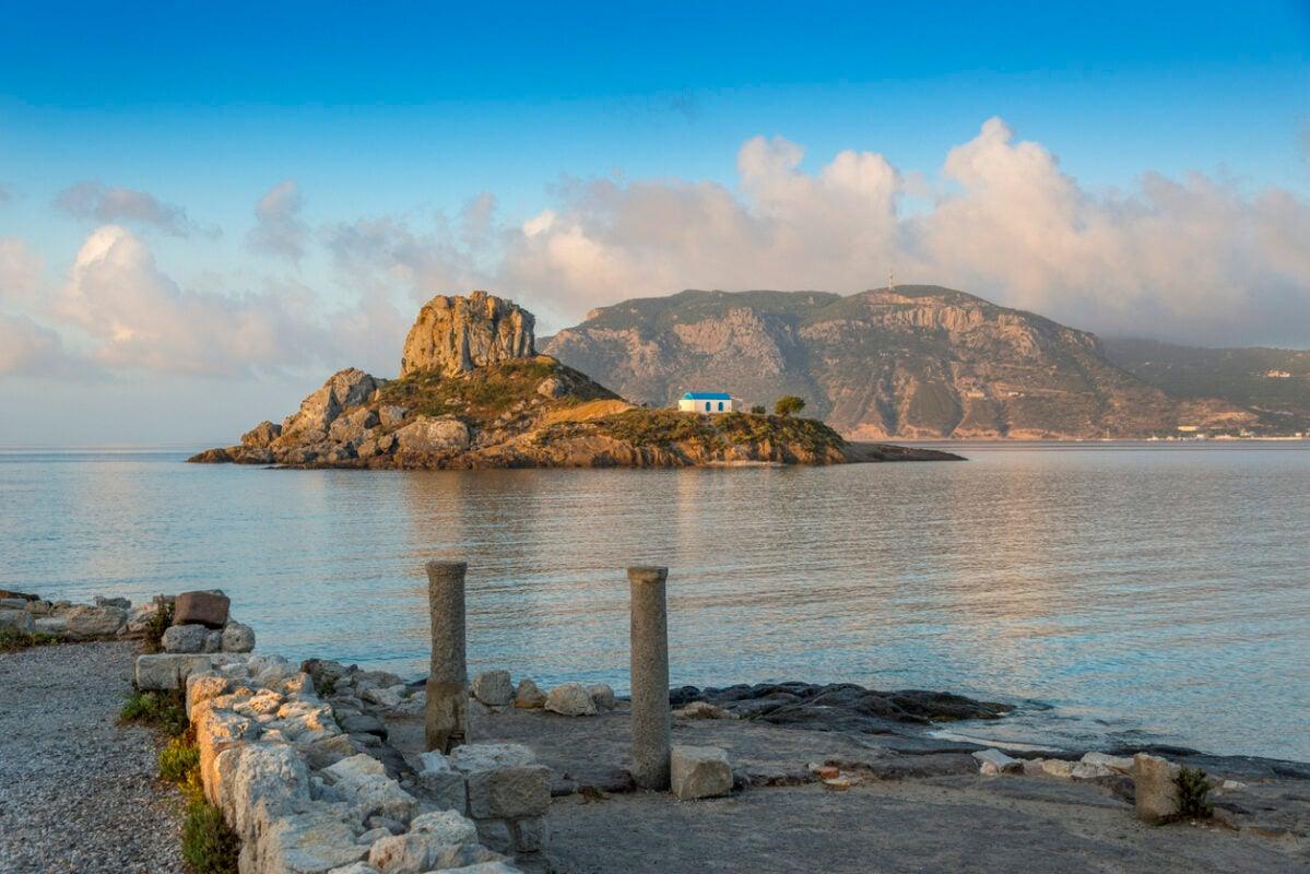 View on little island Kastri near Kos in Kamari bay, Greece