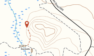 Zone 1, the first wall, is at the marker. The climbs are on the northern aspect of the butte.