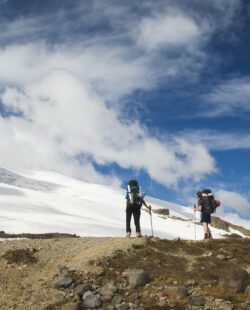 Hikers toward Easton glacier on the souther flank of Mt Baker - 10,781 ft. This image is taken on the Railroad Grade trail, Washington State.