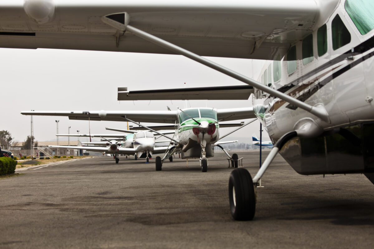 A row of small aircraft used to ferry passengers to and from numerous dirt strips in the bush of Northern Tanzania.