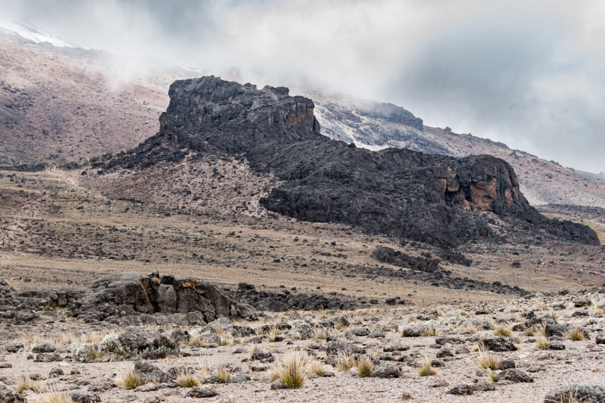 View of the Lava Tower in the alpine desert zone of the Machame route on Mount Kilimanjaro, under a light cloudy sky on a dry day on the Tanzanian volcanic mountain.