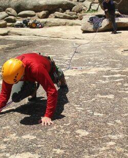 A group of people climbing La Pedriza.