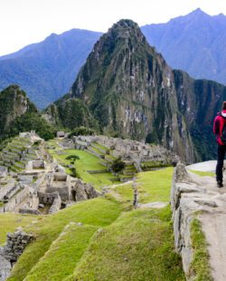 Woman standing in front of Machu Picchu