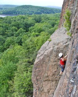 A woman climbing a cliff in Connecticut
